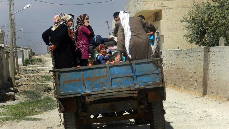 Syrian civilians flee in a vehicle at Houla near Homs, Syria. UPI