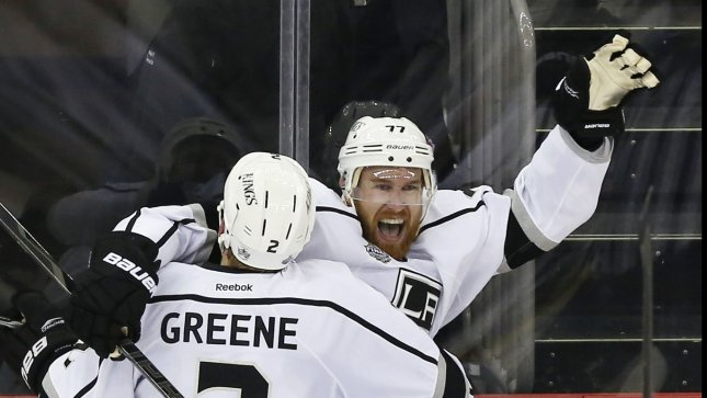 Los Angeles Kings Jeff Carter and Matt Greene react after Carter scores the  game winning goal in overtime against the New Jersey Devils in game 2 of  the NHL ... 2f09175de
