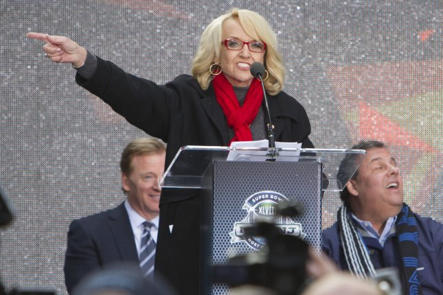 Arizona Govenor Jan Brewer speaks while flanked by NFL Commissioner Roger Goodell (L) and New Jersey Governor Chris Christie (R). UPI/Gary C. Caskey