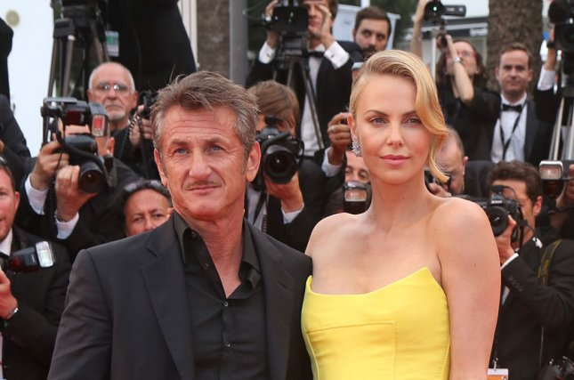 Charlize Theron (R) and Sean Penn at the Cannes International Film Festival screening of Mad Max: Fury Road on May 14, 2015. File Photo by David Silpa/UPI