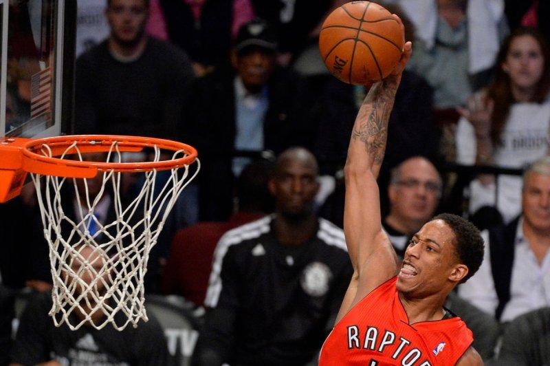 Toronto Raptors guard DeMar DeRozan (10) dunks. File photo by Rich Kane/UPI