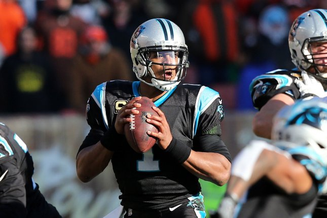 Carolina Panther quarterback Cam Newton looks to pass against the Cleveland Browns in the second half at First Energy Stadium on December 9, 2018. Photo by Aaron Josefczyk/UPI