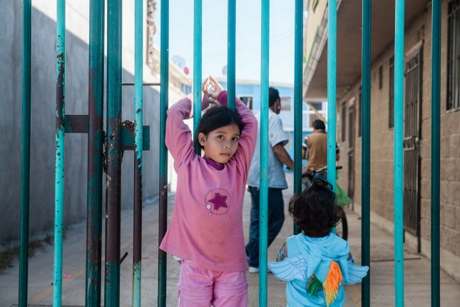 Migrant children, part of a caravan traveling to the United States, are seen near a shelter in Tijuana, Mexico, on November 27, 2018. File Photo by Ariana Drehsler/UPI