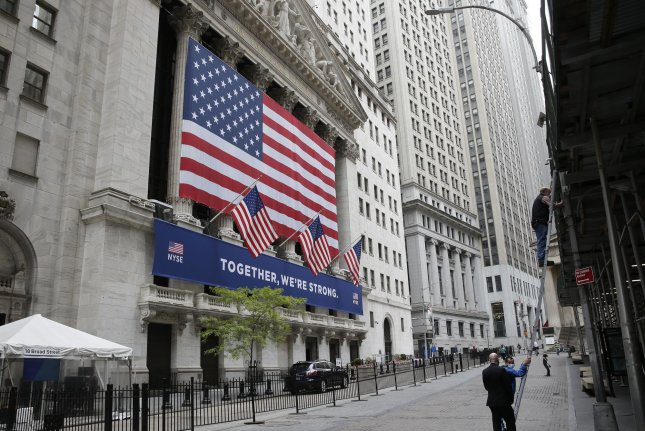 A large American Flag hangs outside the New York Stock Exchange on Wall Street in New York City on Thursday. Photo by John Angelillo/UPI
