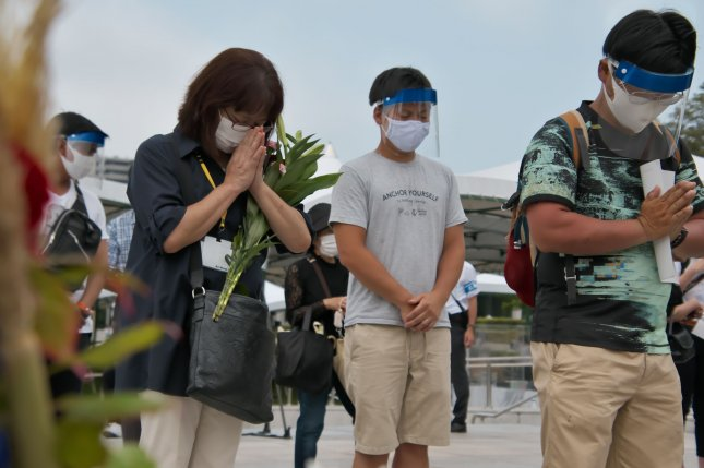 Attendees pray Thursday for the atomic bomb victims at Hiroshima Peace Memorial Park marking the 75th anniversary of the atomic bombing of Hiroshima, Japan. Photo by Keizo Mori/UPI