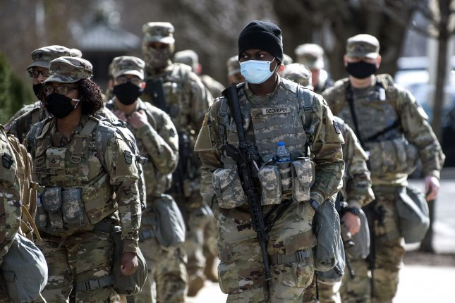 Members of the National Guard patrol near the U.S. Capitol in Washington, D.C., on Thursday. Photo by Kevin Dietsch/UPI