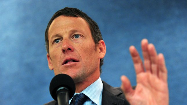 Lance Armstrong delivers remarks at a press conference held to urge Congress to oppose cuts to cancer research and prevention programs, in Washington on March 24, 2011. UPI/Kevin Dietsch