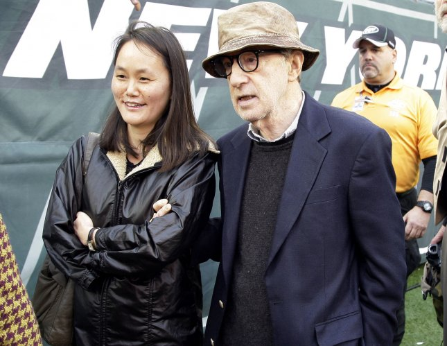 Woody Allen and Soon-Yi walk on the field before the Miami Dolphins play the New York Jets in week 8 of the NFL season at MetLife Stadium in East Rutherford, New Jersey on October 28, 2012. the Dolphins defeated the Jets 30-9. UPI /John Angelillo