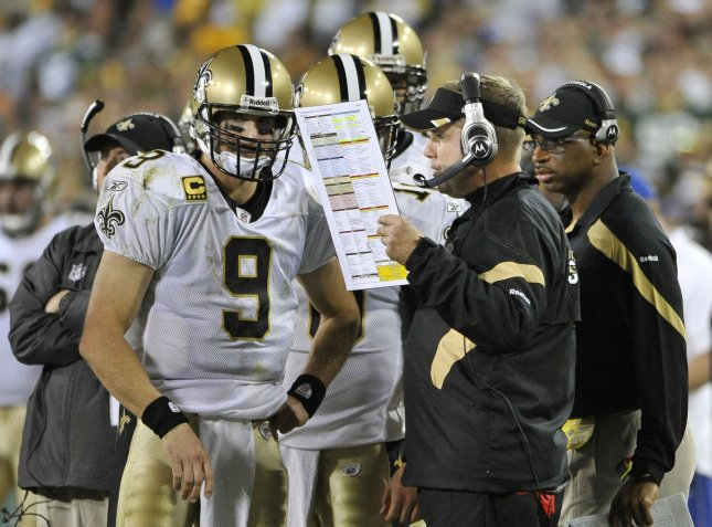 New Orleans Saints head coach Sean Payton (R) is shown talking ith quarterback Drew Brees during a game in September. Payton was injured in a sideline collision with one of his players Sunday and underwent surgery Monday. UPI/Brian Kersey