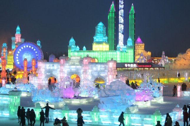 Chinese and foreign tourists visit the annual International Ice and Snow Sculpture Festival in Harbin, the capital of China's Northeast Heilongjiang Province, January 14, 2015. The festival is the largest of its kind in the world, showcasing the largest ice and snow sculptures in the world as well. Photo by Stephen Shaver/UPI