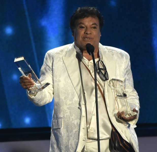 Latin artist Juan Gabriel has died of an apparent heart attack at age 66. Gabriel (above) holds the PKG award on stage during the 2016 Billboard Latin Music Awards and Show at the Bank United Center, University of Miami, Miami, Florida on April 28. Photo by Gary I Rothstein/UPI