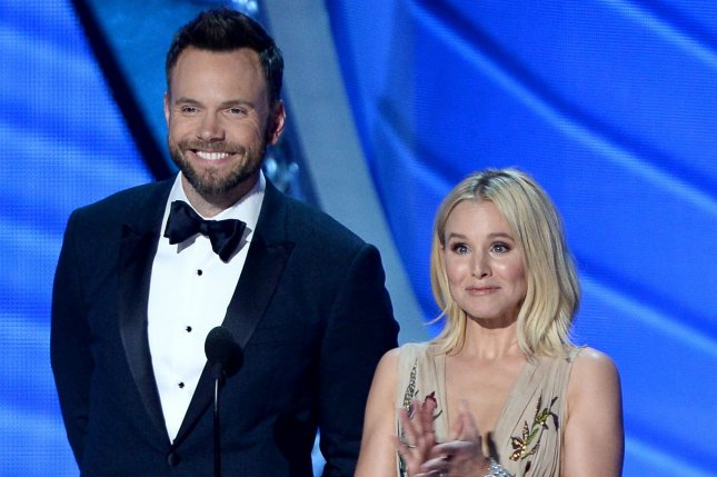(L-R) Actors Joel McHale and Kristen Bell speak onstage during the 68th annual Primetime Emmy Awards in Los Angeles on September 18, 2016. File Photo by Jim Ruymen/UPI
