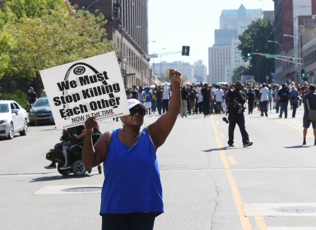 A protester chants as a group moves through the streets of St. Louis following the announcement of a non-guilty verdict of a former white St. Louis policeman in the 2011 shooting of a black man, in St. Louis on September 15, 2017. Jason Stockley was acquitted of first degree murder charges in the fatal shooting of Anthony Lamar Smith on Dec. 11, 2011 following a high-speed chase. Protesters have vowed civil disobedience. Photo by Bill Greenblatt/UPI