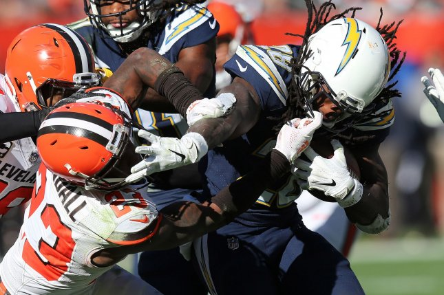 Los Angeles Chargers running back Melvin Gordon III and Cleveland Browns defensive back Damarious Randall (L) grab each other's face masks during a run on October 14, 2018 at FirstEnergy Stadium in Cleveland, Ohio. Photo by Aaron Josefczyk/UPI