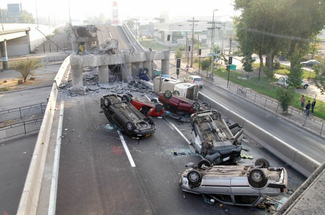 Wrecked vehicles are seen on a destroyed highway in Santiago, Chile, on February 28, 2010, after an 8.8-magnitude earthquake struck the country on February 27. File Photo by Ivan Lepe/UPI