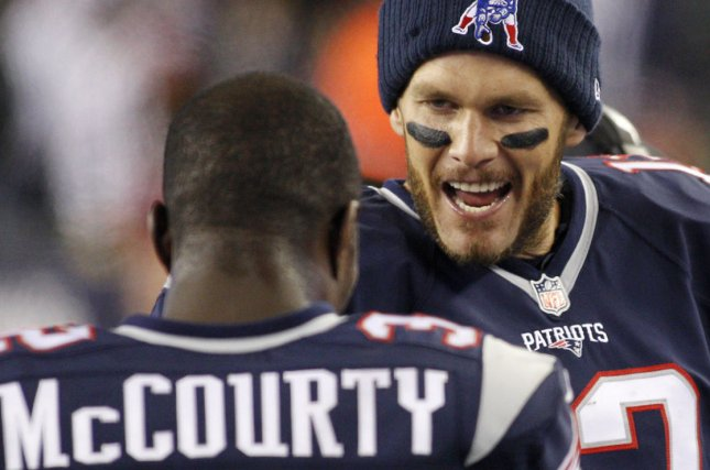 New England Patriots defensive back Devin McCourty (L) said he was more concerned this off-season about where his family would end up and his own free agency than he was with Tom Brady's (R) free agency. File Photo by Matthew Healey/UPI