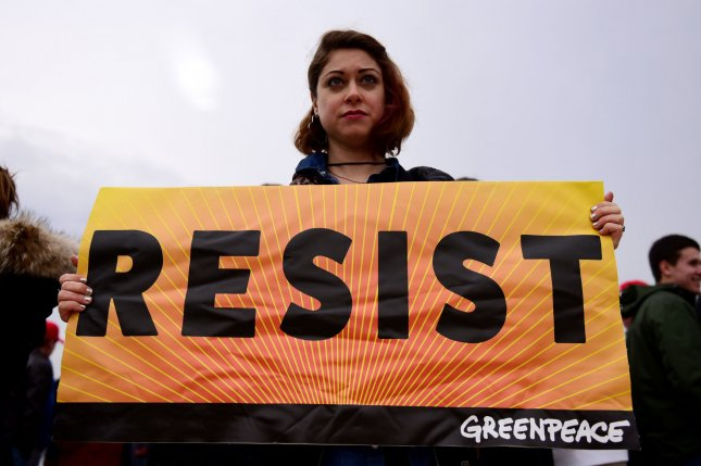Greenpeace protesters gather at Donald Trump's inauguration ceremony at the Capitol on January 20, 2017, in Washington, D.C. On Sept. 15, 1971, the environmental organization Greenpeace was founded by 12 members of the Don't Make A Wave committee of Vancouver, British Columbia. File Photo by Michael Wiser/UPI