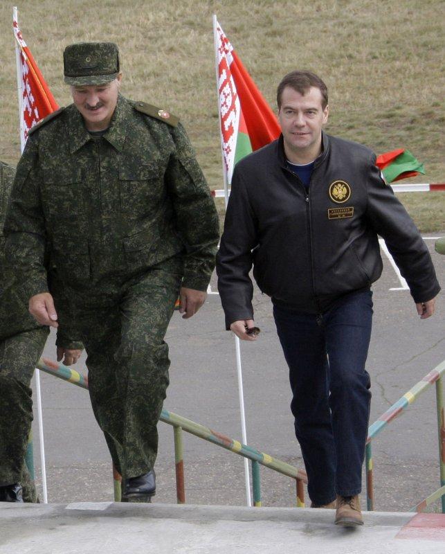 Russian President Dmitry Medvedev (R) and Belorussian President Alexander Lukashenko (R) walk during the final stage of Zapad-2009 (West 2009) Russian-Belarus joint military exercises at at Obuz-Lesnovsky training range near Brest in western Belarus on September 29, 2009. UPI/Anatoli Zhdanov