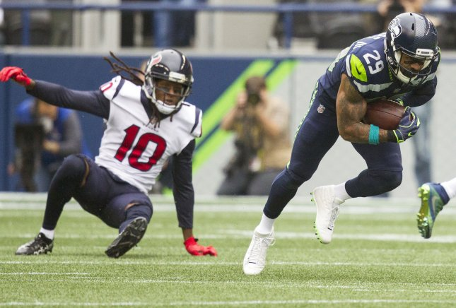 Seattle Seahawks safety Earl Thomas intercepts a pass intended for Houston Texans receiver DeAndre Hopkins, returning it for a 78-yard touchdown during their game in October. Photo by Jim Bryant/UPI