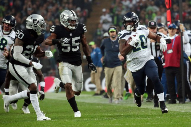 Seattle Seahawks running back Rashaad Penny (20) runs with the football against the Oakland Raiders on October 14, 2018 at Wembley Stadium in London. Photo by Hugo Philpott/UPI