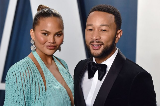 Chrissy Teigen (L) discussed Miles and Luna, her son and daughter with John Legend (R), and her approach to parenting in the spring-summer issue of Glamour U.K. File Photo by Christine Chew/UPI