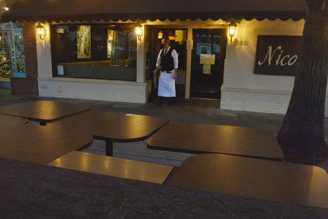 Empty restaurant tables are see along the Pacific Coast Highway in Long Beach, Calif., on December 2 amid closures caused by COVID-19 restrictions. File photo by Jim Ruymen/UPI