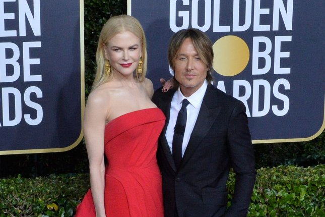 Keith Urban (R), pictured with Nicole Kidman, released the song Crimson Blue ahead of its debut in Kidman's series Nine Perfect Strangers. File Photo by Jim Ruymen/UPI