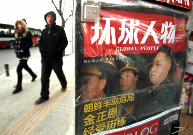 A Chinese magazine featuring a front page story on the future successor of North Korea's leader Kim Jong-il goes on sale at a newsstand in Beijing December 14, 2010. UPI/Stephen Shaver