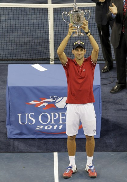 Novak Djokovic of Serbia holds up the Championship Trophy after his match against Rafael Nadal of Spain in the Men's Final in Arthur Ashe Stadium at the U.S. Open Tennis Championships at the Billie Jean King National Tennis Center in New York City on September 12, 2011. Djokovic defeats Nadal 6-2,6-4,7-6,6-1. UPI/John Angelillo