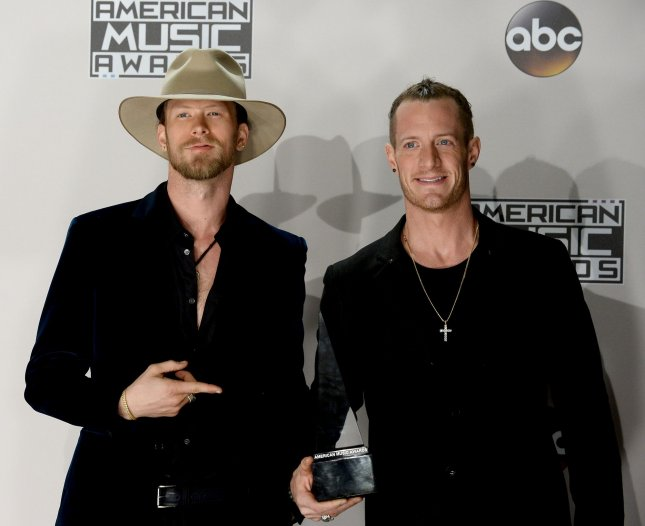 Singers Brian Kelley (L) and Tyler Hubbard of Florida Georgia Line appear backstage with the award for Favorite Country Duo or Group during the 2016 American Music Awards on November 20, 2016. The pair released a video for their collaboration with the Backstreet Boys, which featured the two groups surprising their wives with special gifts and gestures. File Photo by Jim Ruymen/UPI