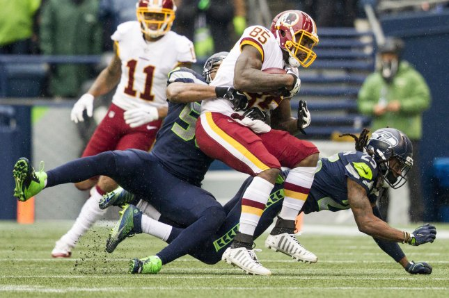 Seattle Seahawks linebacker D.J. Alexander (58) and Seattle Seahawks cornerback Richard Sherman (25) wraps up Washington Redskins tight end Vernon Davis (85) during the second quarter in their game against the at CenturyLink Field in Seattle, Washington on November 5, 2017. File photo by Jim Bryant/UPI