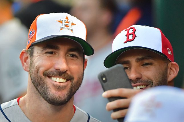 Houston Astros pitcher Justin Verlander (L) takes a selfie in the American League dugout during MLB's All-Star Game on July 17 at Nationals Park in Washington, D.C. Photo by Kevin Dietsch/UPI
