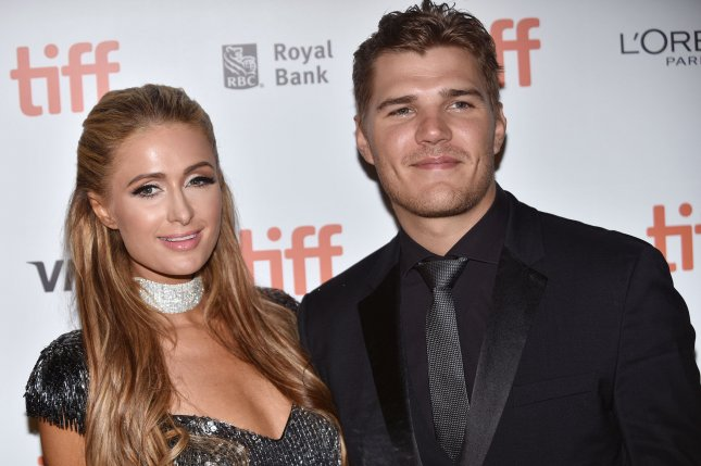 Paris Hilton (L), pictured with Chris Zylka, said she's focused on herself following her broken engagement to the actor. File Photo by Christine Chew/UPI