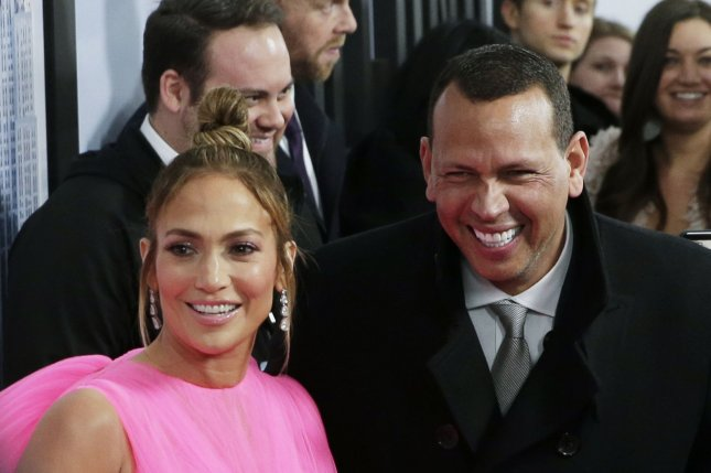 Alex Rodriguez (R) poses with his girlfriend Jennifer Lopez. The former baseball star will appear in a Super Bowl ad for Planters Peanuts. File Photo by John Angelillo/UPI