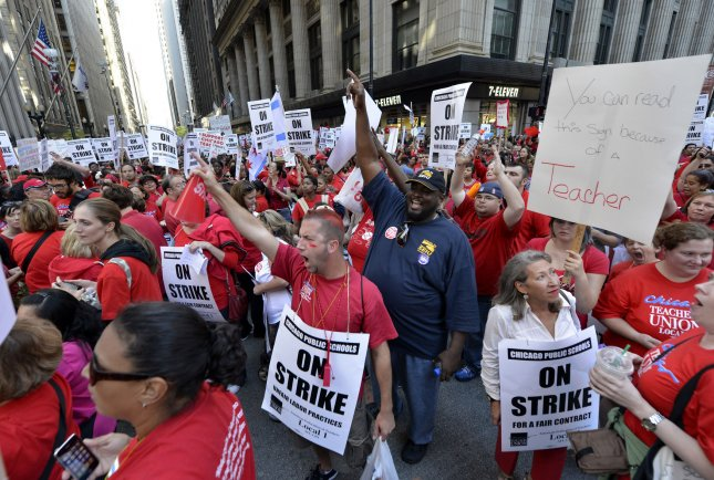 Members of the Chicago Teacher's Union and their supporters march in front of the Chicago Public Schools headquarters on September 10, 2012 in Chicago. The union said the city's latest deal was $38 million short of its goal after 14 hours of negotiations in its latest strike on Saturday. File Photo by Brian Kersey/UPI