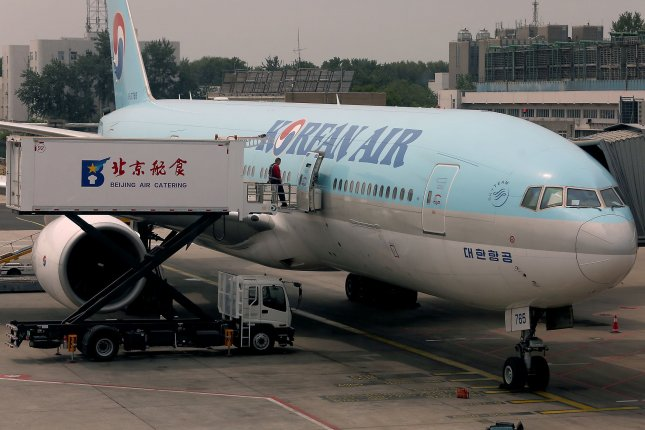 A Korean Air jetliner is seen parked at a passenger gate at the airport in Beijing, China. File Photo By Stephen Shaver/UPI