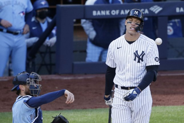 New York Yankees outfielder Aaron Judge (R) reacts after taking a pitch in the ninth inning against the Toronto Blue Jays on Thursday at Yankee Stadium. Photo by John Angelillo/UPI