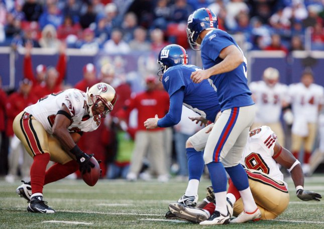 New York Giants John Carney (5) and Jeff Feagles watch San Francisco 49ERS Nate Clements picks up the ball after a blocked field goal and run for a 74 yard touchdown in the fourth quarter at Giants Stadium in East Rutherford, New Jersey on October 19, 2008.The Giants defeated the 49ERS 29-17. (UPI Photo/John Angelillo)