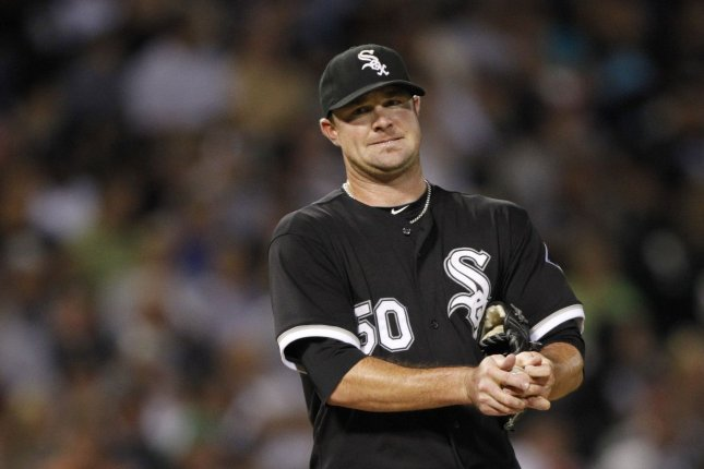 Former Chicago White Sox starting pitcher John Danks rubs up a new ball during the seventh inning against the Minnesota Twins at U.S. Cellular Field in Chicago on September 14, 2010. UPI/Brian Kersey