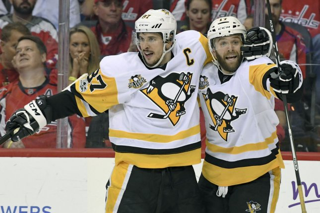 Pittsburgh Penguins right wing Bryan Rust (17) is congratulated by center Sidney Crosby (87). File photo by Mark Goldman/UPI