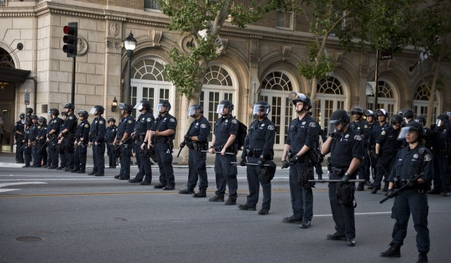 Police block off a street after a rally for then-presidential candidate Donald Trump in San Jose, Calif. on June 2, 2016. On Friday, a panel of federal judges said the San Jose Police Department put Trump supporters in danger by exposing them to 'violent protesters.' File Photo by Terry Schmitt/UPI