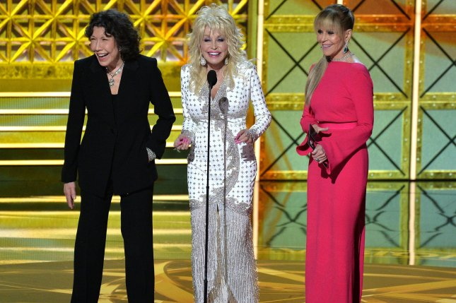 Jane Fonda (R) and Lily Tomlin (L), pictured with Dolly Parton, discussed 9 to 5 and their plans for a followup movie. File Photo by Jim Ruymen/UPI