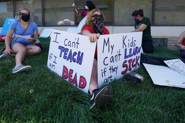 Concerned educators, including St. Louis Public School first-grade teacher Cindy Digar, attend a protest at district headquarters in St. Louis. Mo., on July 13. Teachers nationwide have expressed some concern about resuming classes in the fall. Photo by Bill Greenblatt/UPI