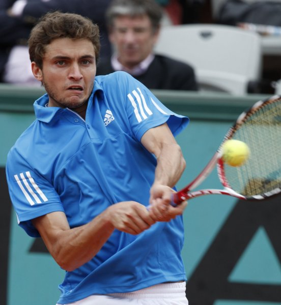 Gilles Simon, shown in a 2009 file photo, forced world No. 2 Roger Federer into a five-match thriller before losing a second-round match Wednesday at the Australian Open. (UPI Photo/ David Silpa)
