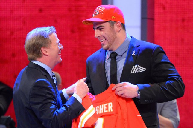 Eric Fisher, offensive tackle from Central Michigan, holds up a Chiefs Jersey and stands next to NFL Commissioner Roger Goodell after the Kansas City Chiefs select him as the #1 overall pick in the 2013 NFL Draft at Radio City Music Hall in New York City on April 25, 2013. UPI /Rich Kane