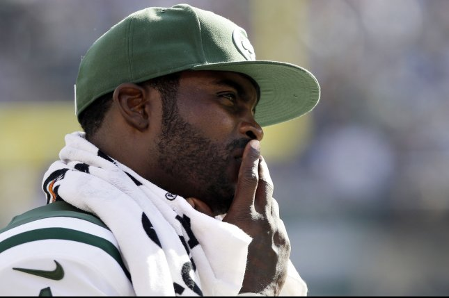 Former New York Jets QB Michael Vick stands on the sidelines in the fourth quarter against the Detroit Lions in week 4 of the NFL season at MetLife Stadium in East Rutherford, New Jersey on September 28, 2014. The Lions defeated the Jets 24-17. UPI /John Angelillo
