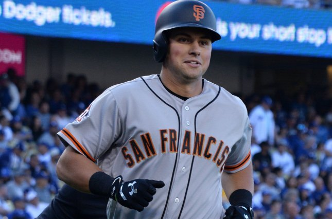 San Francisco Giants' second baseman Joe Panik heads to the dugout after hitting a solo home run in the fifth inning against Los Angeles Dodgers' starting pitcher Clayton Kershaw on March 29 at Dodger Stadium in Los Angeles, Calif. Photo by Jim Ruymen