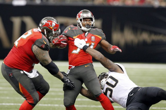 Tampa Bay Buccaneers running back Charles Sims (34) is stopped by New  Orleans Saints middle linebacker Stephone Anthony (50) during the second  quarter on ... c617b2ad58e