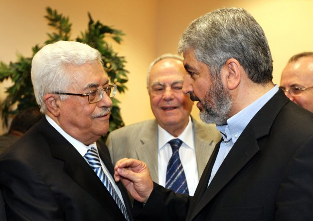 Hamas leader Khaled Meshaal (R) talks with President Mahmoud Abbas (L) during their meeting in Cairo May 4, 2011. The rival factions, Fatah and Hamas, signed a reconciliation accord in Cairo after reaching common ground against Israeli occupation and peace efforts. Mashaal said they had a 'common goal; a Palestinian state with full sovereignty on the 1967 borders with Jerusalem as the capital'. Israeli Prime Minister Benjamin Netanyahu claimed that the reconciliation between the factions as a 'blow to peace', but the US declined to make any comment. UPI\ Mohammed Hosam