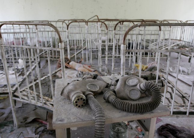 Children's beds, toys and gas masks in an empty day care in the Ukrainian ghost city of Pripyat, near the Chernobyl nuclear station. A man detained in Moscow claims he collected contaminated items from the area because a friend convinced him exposure to radioactive materials would make him immortal. (File/UPI Photo/Sergey Starostenko)